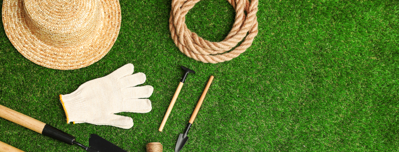 Garden tool & Straw hat laid out on grass