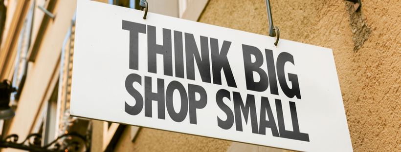 """Think Big, Shop Small"" storefront sign"