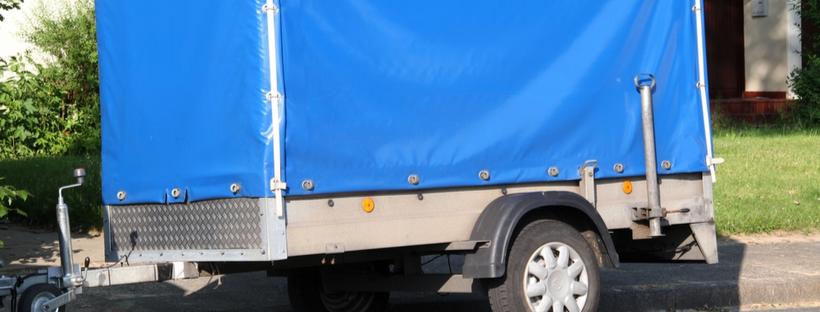 Heavy duty tarp covering trailer