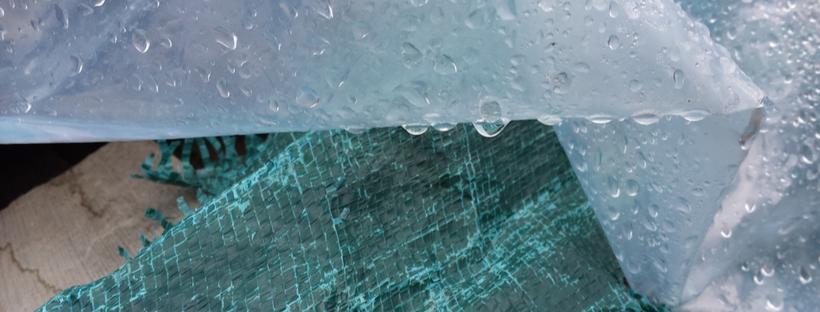 Clear vinyl tarp protecting from rain