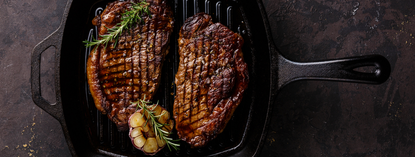 Grilled steak on a cast iron pan